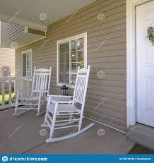 Home With Rocking Chairs And Table On The Porch Stock Photo ... Small Rocking Chair For Nursery Bangkokfoodietourcom 18 Free Adirondack Plans You Can Diy Today Chairs Cushions Rock Duty Outdoors Modern Outdoor From 2x4s And 2x6s Ana White Mainstays Solid Wood Slat Fniture Of America Oria Brown Horse Outstanding Side Patio Wooden Tables Carson Carrington Granite Grey Fabric Mid Century Design Designs Acacia Roo Homemade Royals Courage Comfy And Lovely