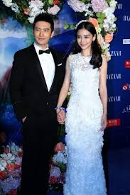 Angelababy And Huang Xiaoming At The 2014 Bazaar Charity Night In Beijing September 19