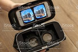 Apple Iphone 7 Rose Gold And Virtual Reality Headset stock photo