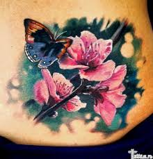 Realistic Butterfly And Flowers Tattoo On Lower Back