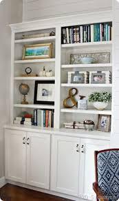 styled family room bookshelves shelving room and living rooms