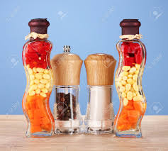 Two Bottles With Red Pepper Beans Carrots For Kitchen Decor Salt And Peper