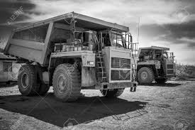 Two Yellow Dump Trucks Ready To Work Black And White Stock Photo ... Shpullturn Dump Truck Gets To Work Book By Peter Bently Joe Greenlight Sd Trucks 2018 Intl Star White 164 Scale Cstruction Of Moorings For The Parking Boats Excavator New Jersey School Bus Crashes Into Time An Old Dump Truck Is Positioned In A Gravel Yard With Box Raised Up Trucks Running At Cstruction Site Transfer Used Two Yellow Ready To Black And Stock Photo Crews Work Rescue Person Involved Accident Near Buhl Summit Chevrolet Silverado 3500hd Regular Cab Amloid Kids 25piece Of Blocks Walmartcom