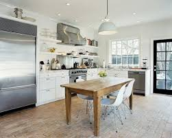 View In Gallery A Kitchen With Stainless Steel Appliances And Brick Flooring