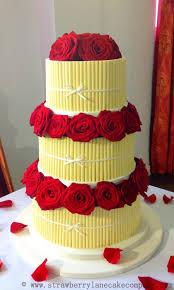 White Chocolate Cigarellos Wedding Cake With Fresh Red Roses on Cake Central