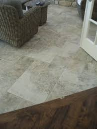 Laminate Floor Transitions To Tiles by Light Tile With A Seamless Transition To Dark Wood Floor Perfect