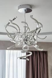 led kronleuchter im modernen wohnzimmer bilder myloview