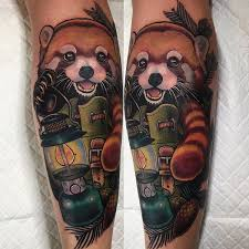 Charming Red Panda In A Camping Bag Tattoo On The Leg