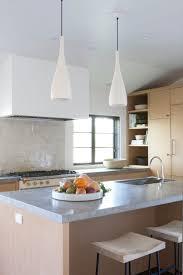 DISC Interiors A Spanish Colonial Revival Home Transformed LA Edition Remodelista Kitchen Design Moroccan Tiles Limestone