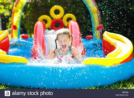 Child Playing In Inflatable Baby Pool Kids Swim Slide And Splash Colorful Garden Play Center Happy Little Girl Sliding Swimming With Water T