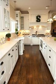 white kitchen cabinets with cherry wood floors light hardwood