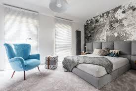 schlafzimmer mit vintage blauem sessel foto bialasiewicz auf envato elements