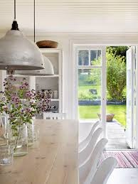 Love The Mix Of Country Style Kitchen With Edgy Industrial Lighting At Low Level Over Dining Table