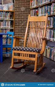Oak Rocking Chair In The Middle Of A Library Editorial ... Rocking Chair Health Uk Kids Toy Horse Story Illustration For Children Little Room With A Wooden This Is The Only Chair Youll Need If Youre Grandparent Of Ikea Ps Rockingchair First Sketches Today Chairs Whats Their Story Souvenirs Tell Stories Part 7 Jim Illinois Fairytale Fniture Silky The Pony Antique Rocking From 1800s Collectors Weekly Buy Storyhome Adjustable Folding Lounge Red Time For Twins