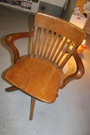 American Swivel Rocking Chair Wood And Cast Iron-design 1920-1930
