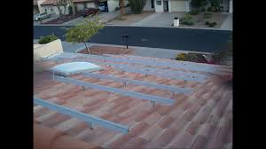 solar panel installation on a tile roof