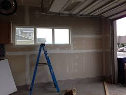 how to build shelves and texture unfinished walls in your garage