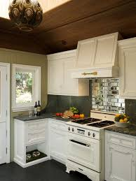 Mountain Style Kitchen Photo In Los Angeles With Recessed Panel Cabinets Mirror Backsplash
