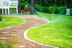 Backyard Residential Garden Grass Field Sprinklers In Action ... Garden Eaging Picture Of Small Backyard Landscaping Decoration Best Elegant Front Path Ideas Uk Spectacular Designs River 25 Flagstone Path Ideas On Pinterest Lkway Define Pathyways Yard Landscape Design Ma Makeover Bbcoms House Design Housedesign Stone Outdoor Fniture Modern Diy On A Budget For How To Illuminate Your With Lighting Hgtv Garden Pea Gravel Decorative Rocks