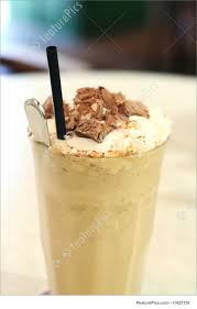 Desserts Cup Of Iced Milk Coffee In Glass With Straw