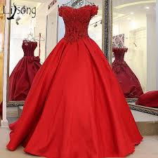 Red Vintage Puffy Ball Gowns V Neck Beaded Bow Saudi Arabic Prom Dresses Appliques Lace