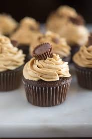 Chocolate Cupcakes With Peanut Butter Frosting And A Mini Reeses Cup Placed On Top
