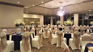 Wedding Reception With Ivory Spandex Chair Covers, Gold Sashes ... Black Tablecloths White Chair Covers Holidays And Events White Black Banquet Chair Covers Hashtag Bg Sashes Noretas Decor Inc Cover Stretch Elastic Ding Room Wedding Spandex Folding Party Decorations Beautifull Silver Sash Table Weddings With Classic Set The Mood Joannes Event Rentals Presyo Ng Washable Pink Wedding Sashes Napkins Fvities Mns Premier Event Rental Decor Floral Provider Reception Room Red Interior