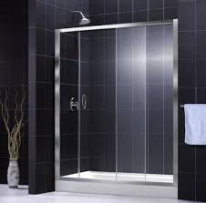 sliding glass shower doors with black wall tile home interiors