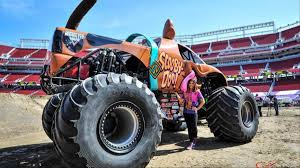 This Badass Female Monster Truck Driver Does Backflips In A Scooby ...