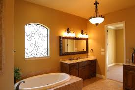 modish bathroom paint colors with tan tile and wrought iron window