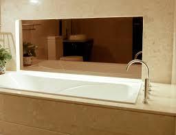 using bronze glass and mirror in bathroom interior design