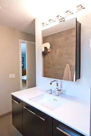 medicine cabinet with lights and electrical outlet bathroom