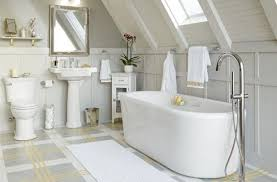 bathroom with wooden vanity and small chandelier over white