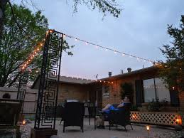 Patio Floor Lighting Ideas by The Happy Homebodies Diy Stringing Patio Cafe Lights