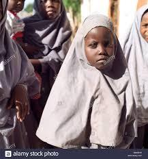 three muslim girls in kenya africa wearing traditional muslim head