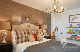 Boys room with wood accent wall plaid and solid bedding