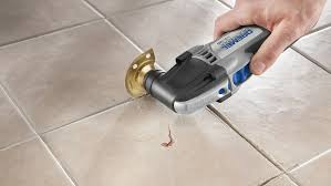 replacing grout between tiles and raking out tiles for regrouting