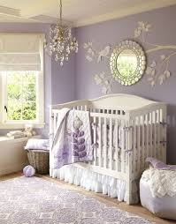 A Classically Styled White Crib Pops Against Lavender Walls Sheeting And Other Accents To Give