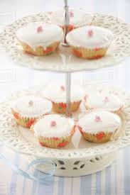 Fairy Cakes Decorated With White Icing And Candied Flowers