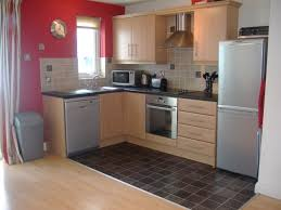 Beige Wooden Kitchen Cabinet And Red Wall Theme Connected Black Flooring Ideas Dining Room Living Countertops