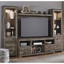 At HOME Trinell 4 Piece Entertainment Center In Brown