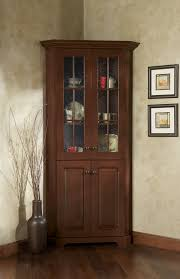 Stunning Dark Brown Polished Dining Corner Cabinet With Artwork Portrait Frames As Decorate In Lovely Room Furniture Ideas