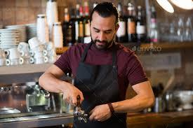 Barista Man Making Espresso At Bar Or Coffee Shop Stock Photo By Dolgachov