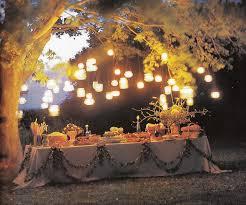 Highlight A Dessert Table Or Gift At An Outdoor Wedding By Suspending Mason Jar Lanterns