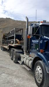 100 National Trucking Specialized HaulForHire Transportation Hauling Heavy Equipment