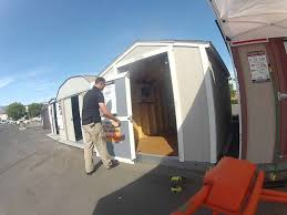 how an asm can re hang a tuff shed door youtube