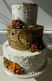 3 Tier Wood Tree Trunk And Lace Buttercream Wedding Cake Decorated With Fall Colored