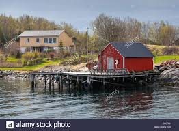Traditional Norwegian Red Wooden Fishing Boat Barn On The Sea ... Boat On A Lake Free Photo Barn Images Red Wooden Fishing With Small Royalty Stock Budget Boat Barn Lake Conroe Storage Old Traditional Norwegian Photos Jim Rogers Architects House And Dock Pole Project Ithaca Farm South Bay Historic Restoration Fund 9 Reasons Why You Should Get An Agricultural Metal Collection Of Solutions Carports Garages The With Barns Dm Marine Sales Service Repairs