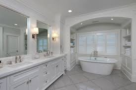 bathtub alcove with white arabesque tiles transitional