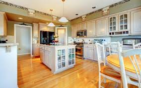 The Bright And Bold Nature Of This Kitchen Is Highlighted By Warm Hardwood Flooring Rustic